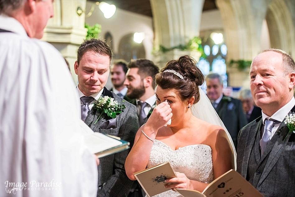 Emotional bride at St Katherine's church Holt