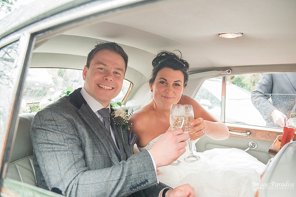 Champagne in wedding car St Katherine's church Holt