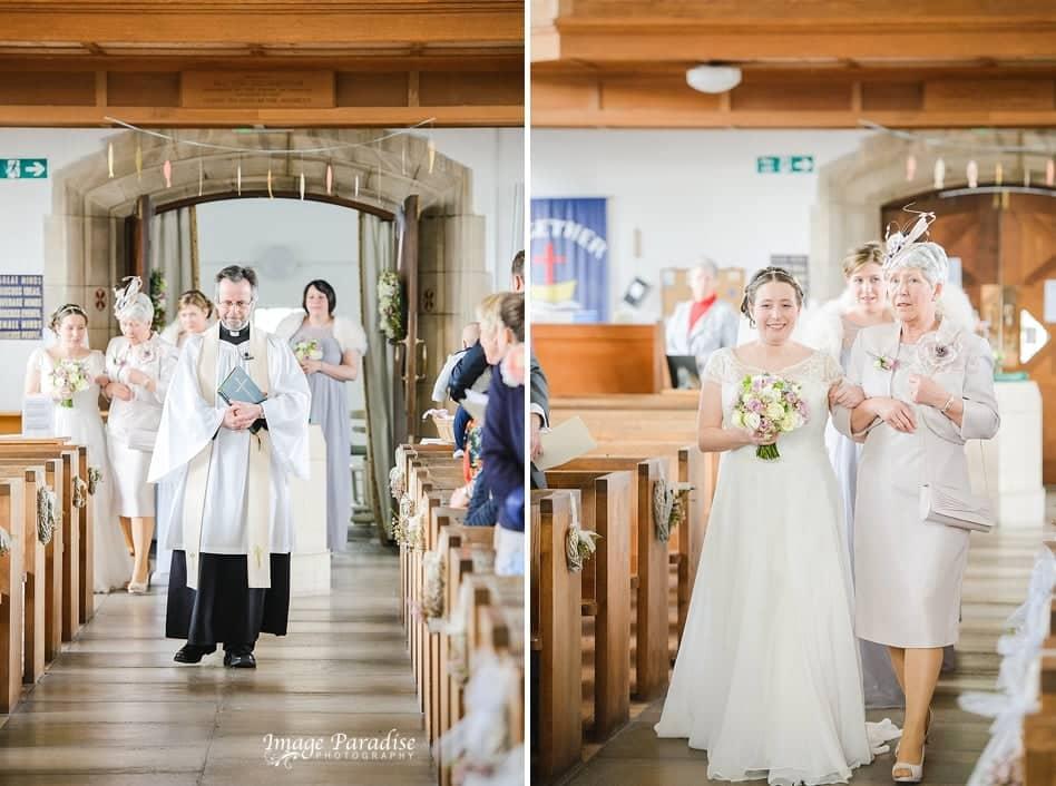Bride walking down the aisle at St Cuthbert church