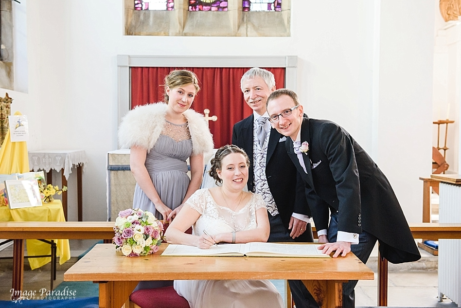 signing the register at St Cuthbert church