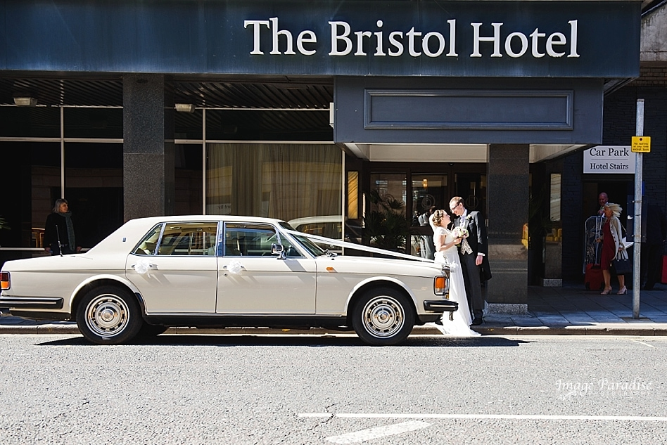 Bride and groom outside The Bristol hotel