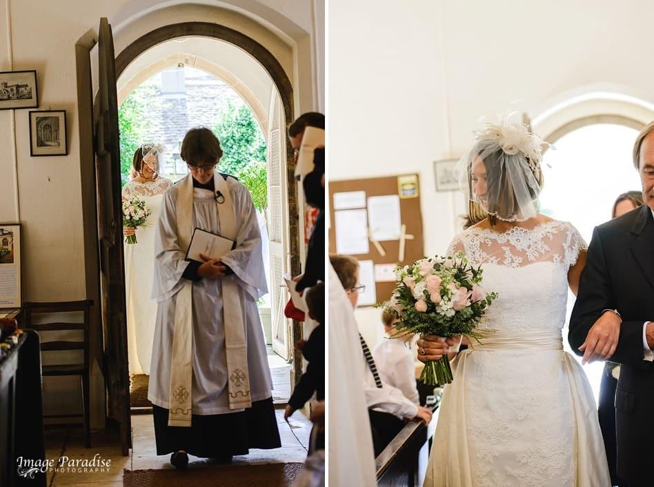 Bride walking down aisle of Beverston church