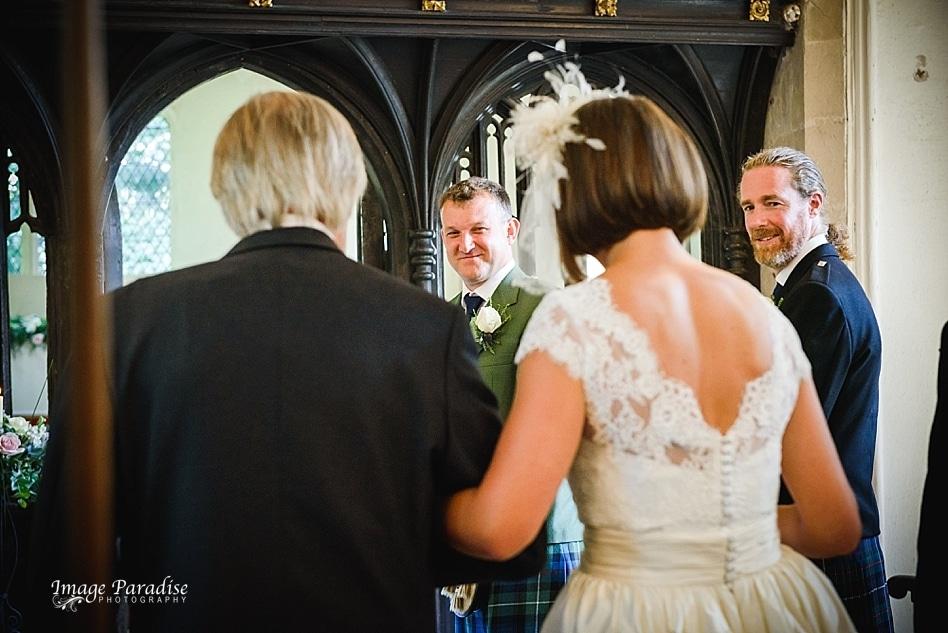 Beverston church wedding happy groom
