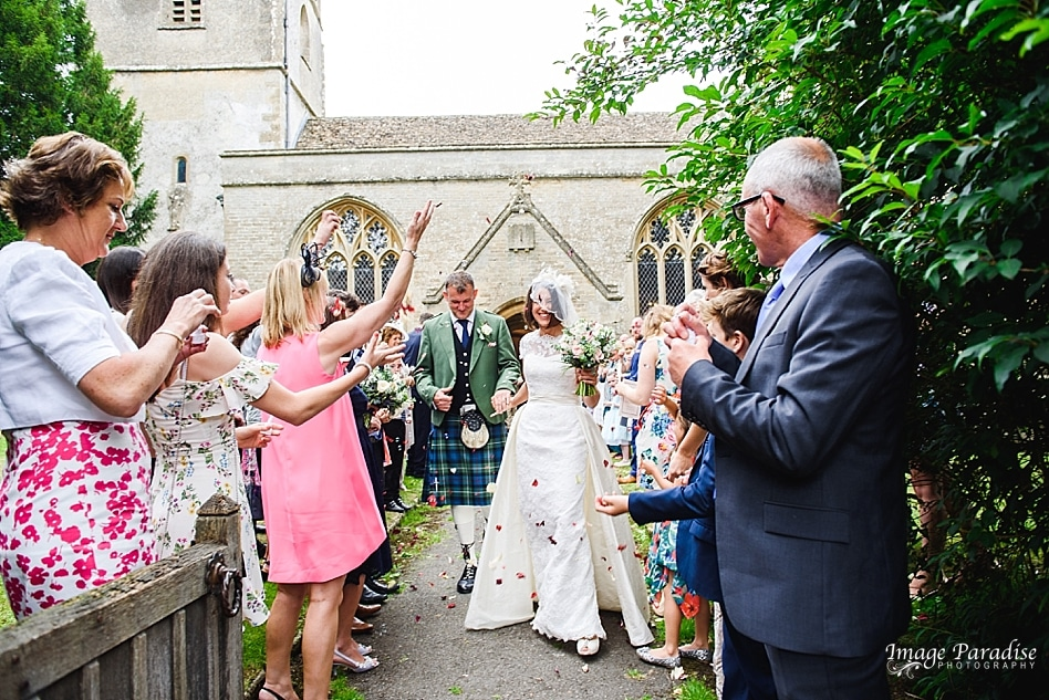 confetti being thrown at a Cotswold wedding Beverston