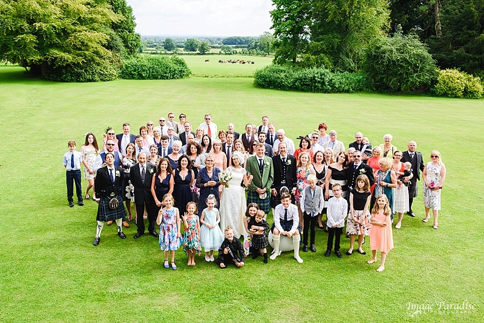 group photo of wedding party Chavenage House