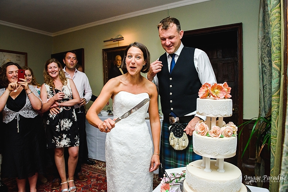 cutting of the wedding cake at Chavenage House