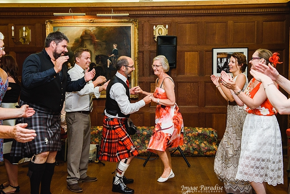 Scottish style dancing at a wedding in Chavenage House