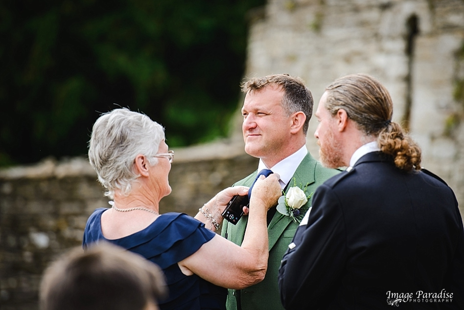 Scottish Groom getting prepared for Chavenage House wedding