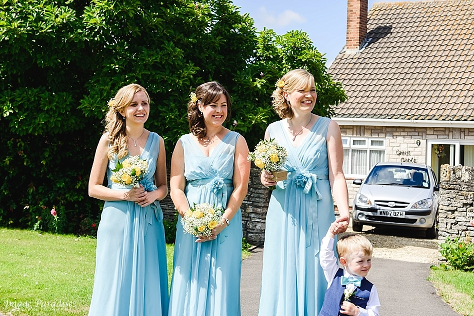 bridesmaids waiting for brides arrival at St Michaels church