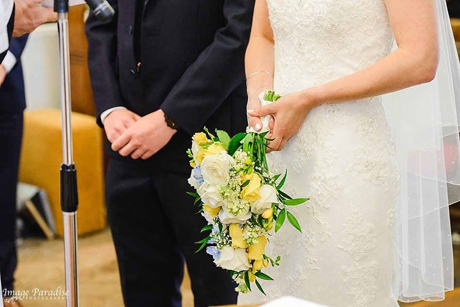 close up shot of a bride holding her wedding bouquet