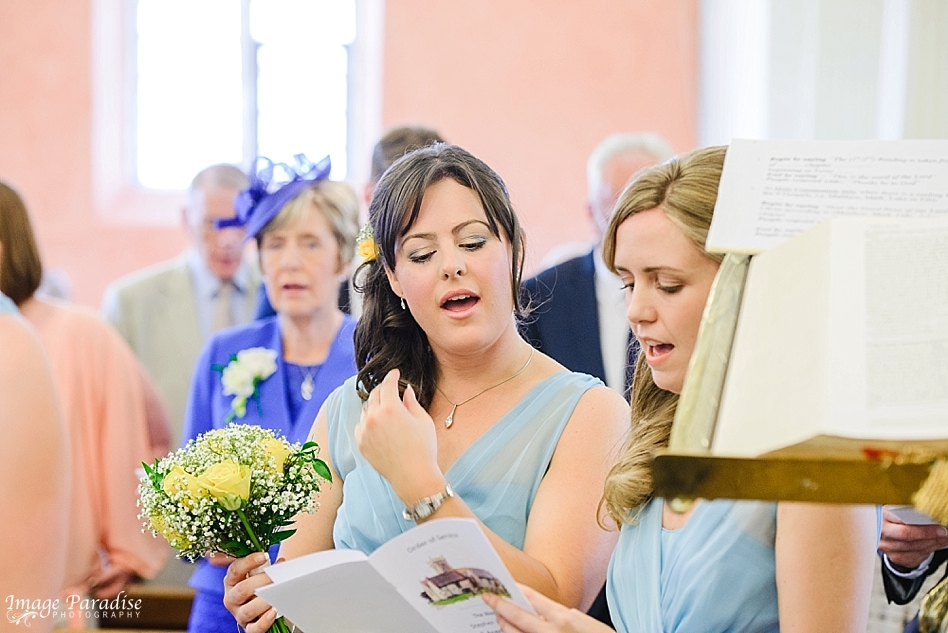 Hymns being sang at a wedding at St Michaels church