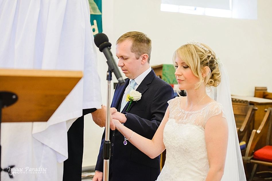 Bride & Groom being blessed on wedding day at St Michaels church Bristol