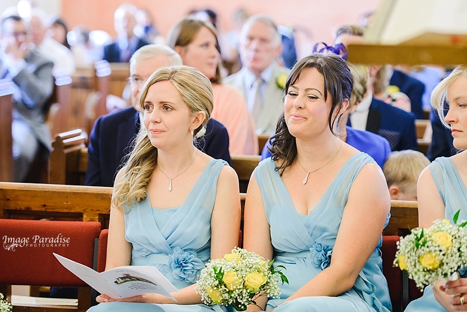 Guests listening to wedding service at St Michaels church