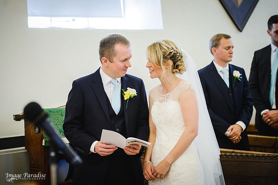 Bride and groom looking in each others eyes at St Michaels church Bristol