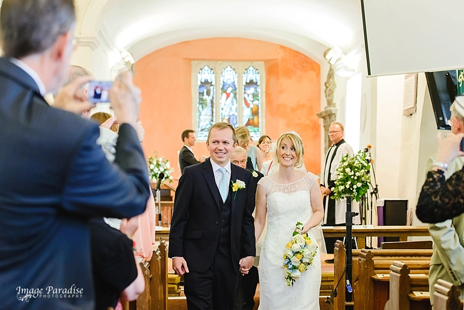 Married couple walk down the aisle at St Michaels church Bristol