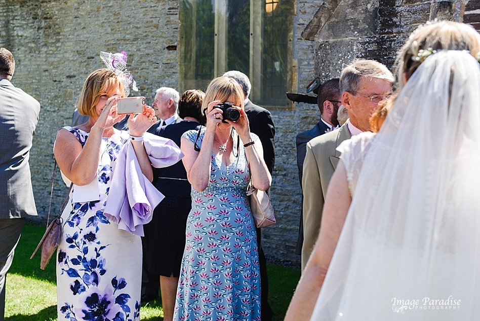 Guests taking photos at St Michaels church