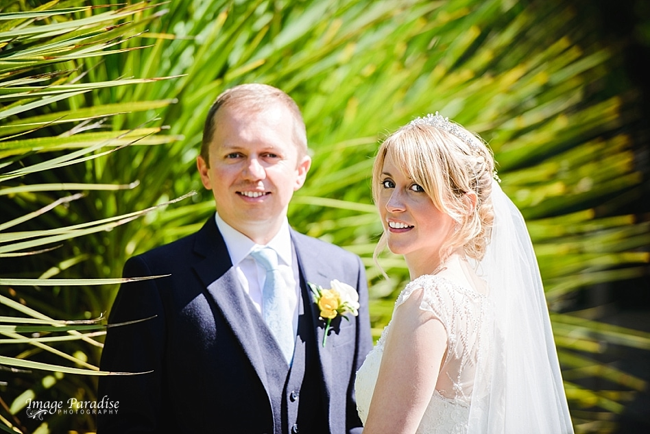 Bride & groom in the garden of the Aztec west hotel
