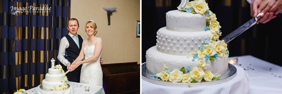 Bride and groom cutting wedding cake at Aztec West hotel wedding