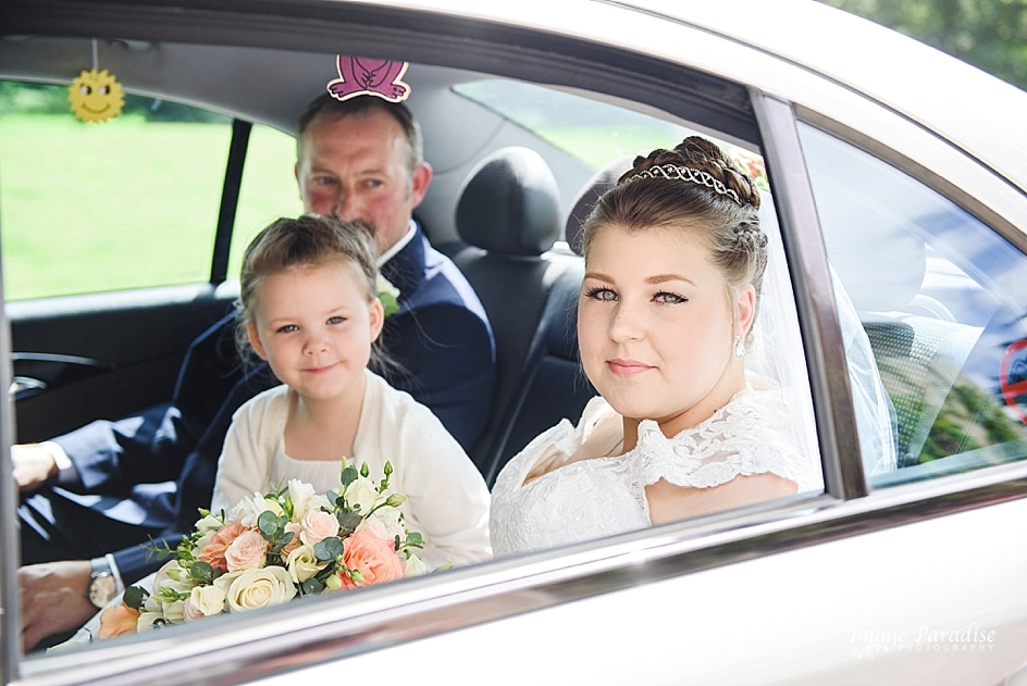 Bride arrives in car to Mercure Bristol North