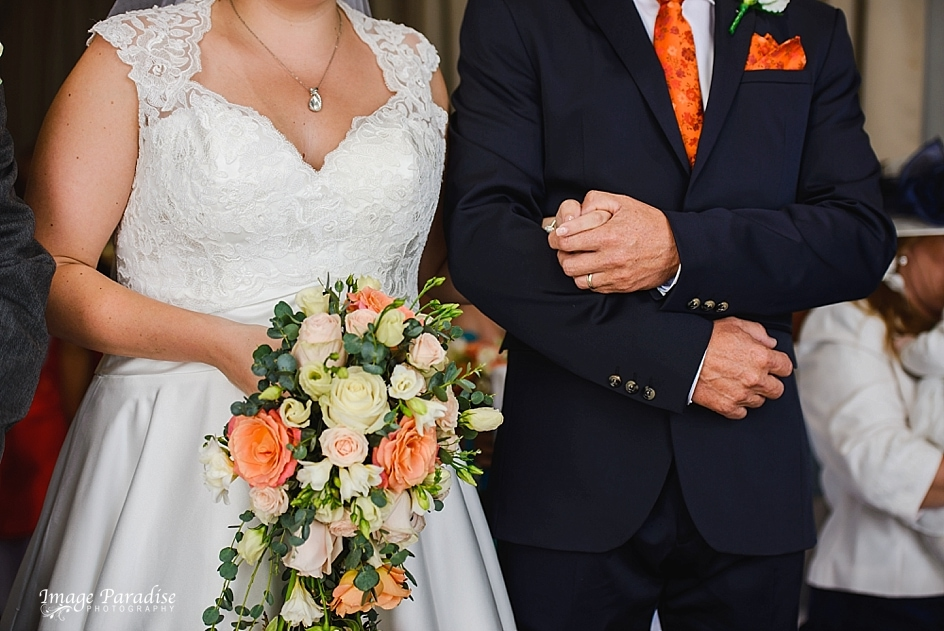 Father of the bride arm in arm at wedding ceremony Mervure Bristol North