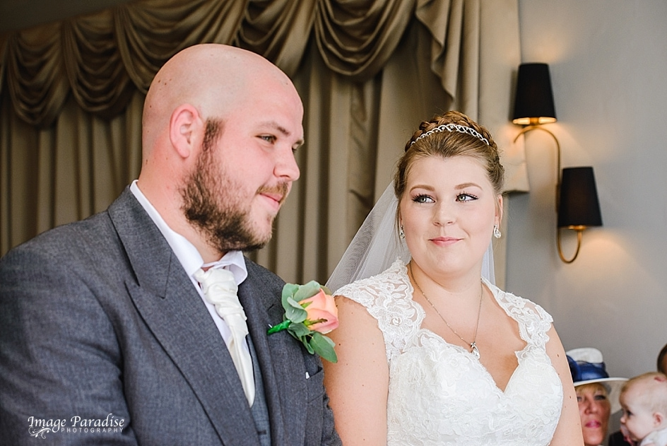 Bride smiles at her groom at the Mercure Bristol North