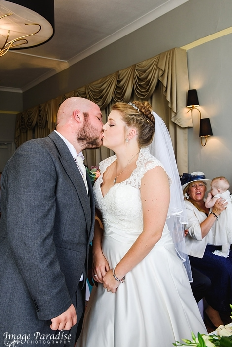 Bride & Groom kiss at their wedding Mercure Bristol North