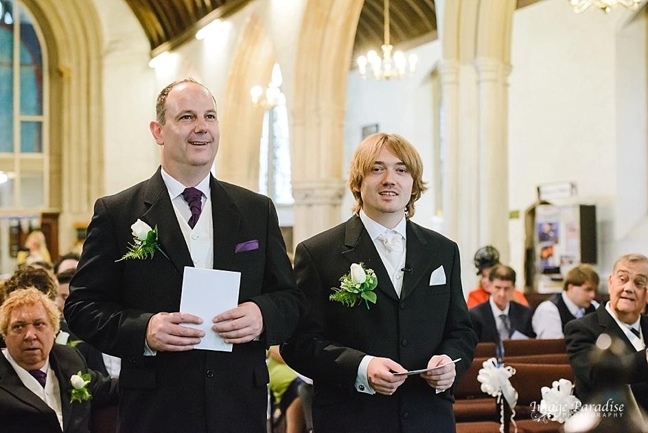 Groom & best man stood at the altar St Mary's church
