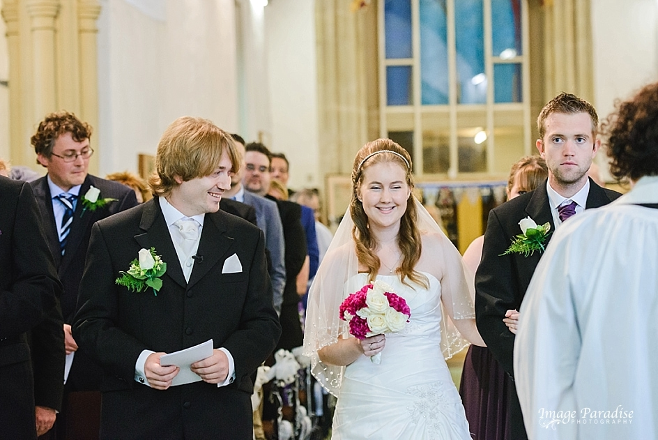 Bride walking down the aisle of St Mary's church Yate