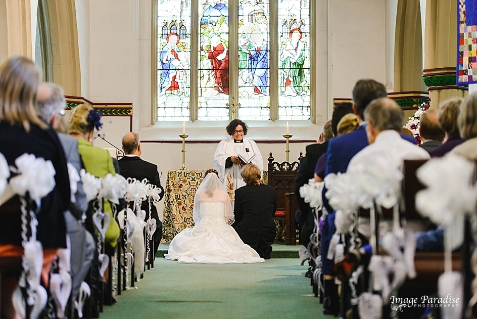 Bride & Groom being blessed at St Mary's church Yate