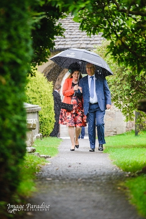guests walking through the rain at St Mary's church