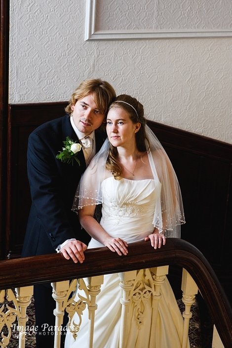 Bride & Groom on the stairs of Stanshawes