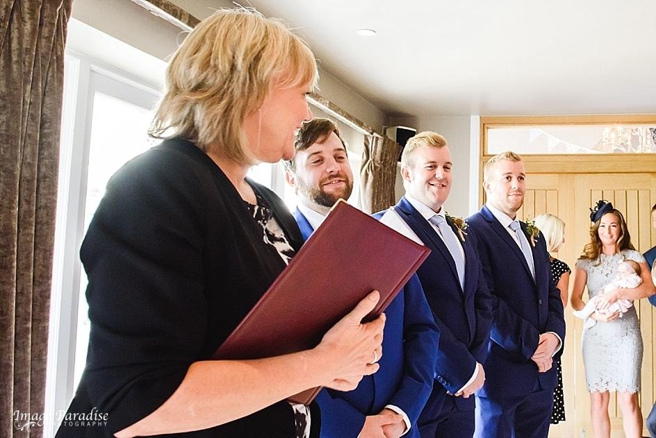 Groomsmen admiring bride