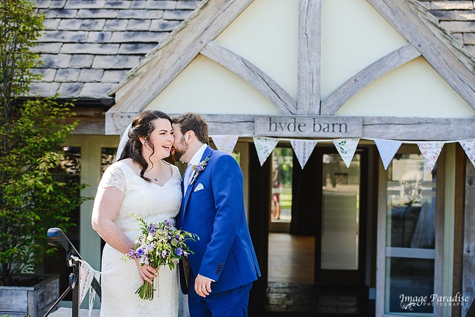Bride & groom outside of Hyde barn