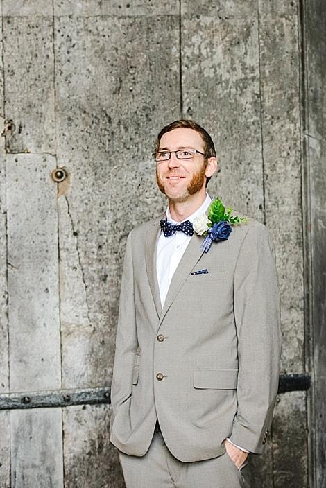 Groom stood in the doorway of Tewkesbury Abbey wedding venue