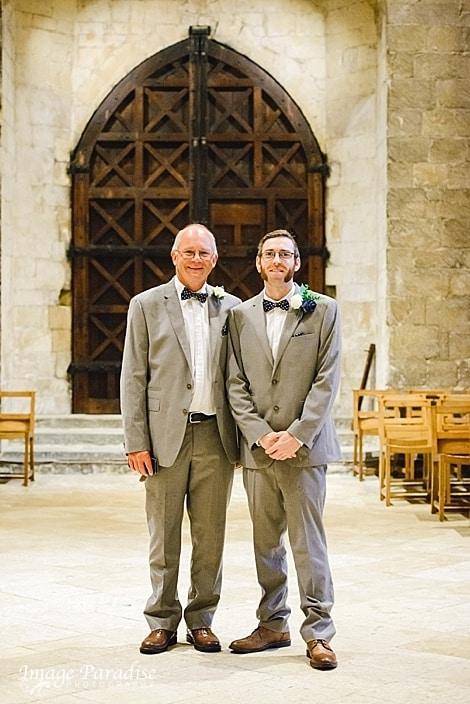 Groom and best man inside Tewkesbury Abbey wedding venue