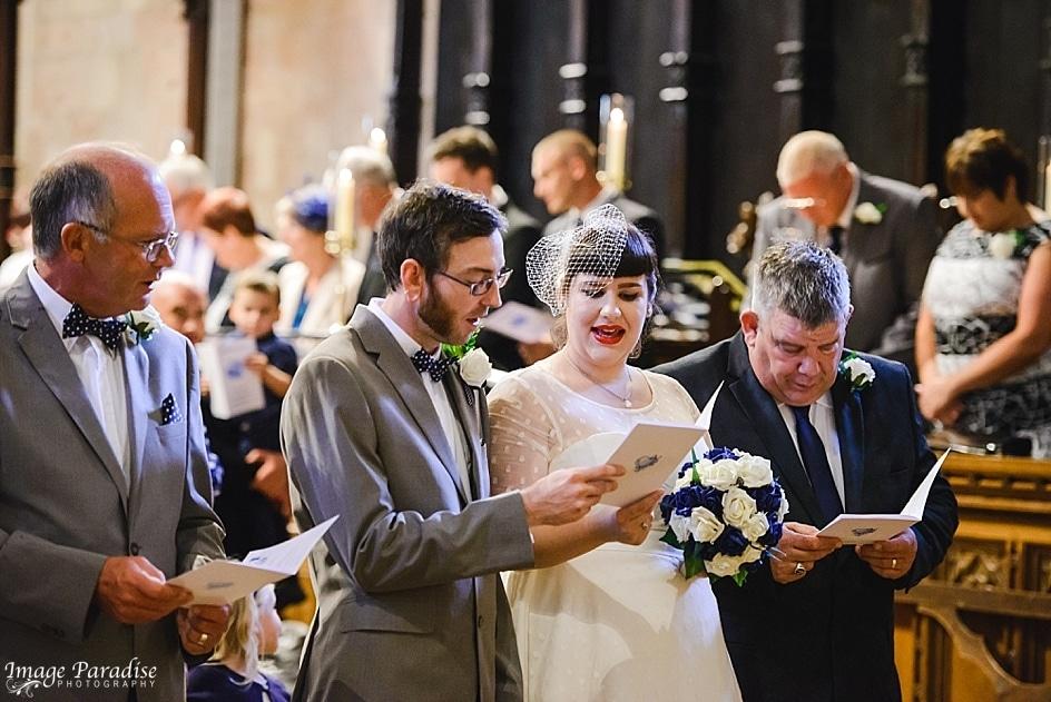 Wedding party singing hymns at Tewkesbury Abbey