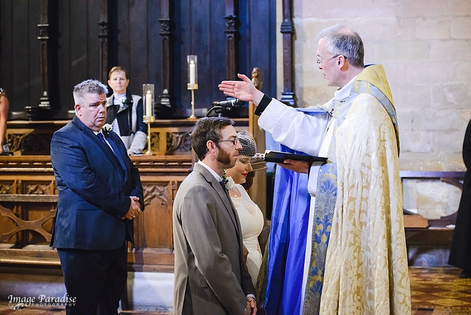Newly married couple being blessed at Tewkesbury Abbey