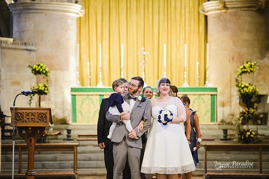 Couple just married inside Tewkesbury Abbey wedding venue
