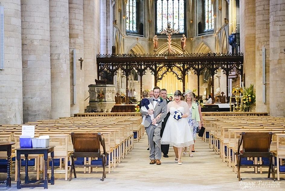Wedding party leaving Tewkesbury Abbey wedding ceremony