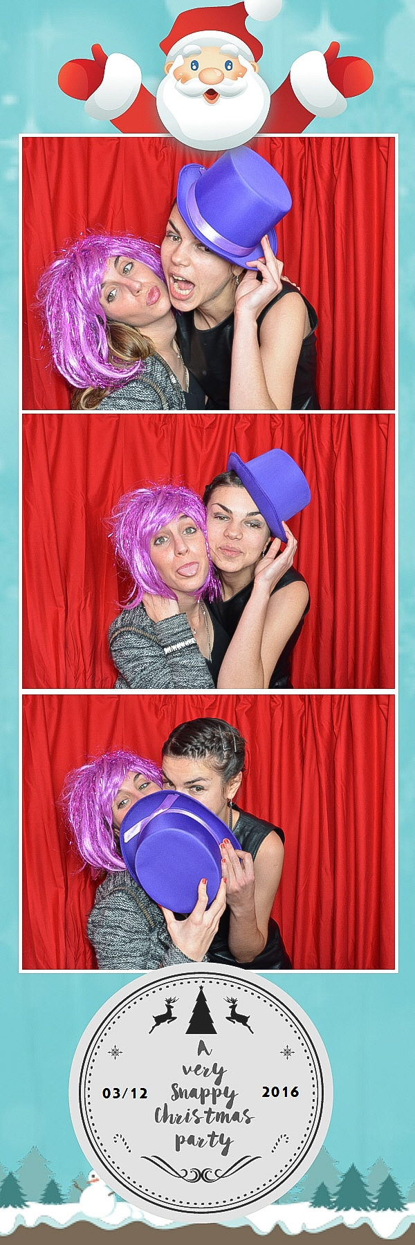 two girls in photo booth wearing pink wigs