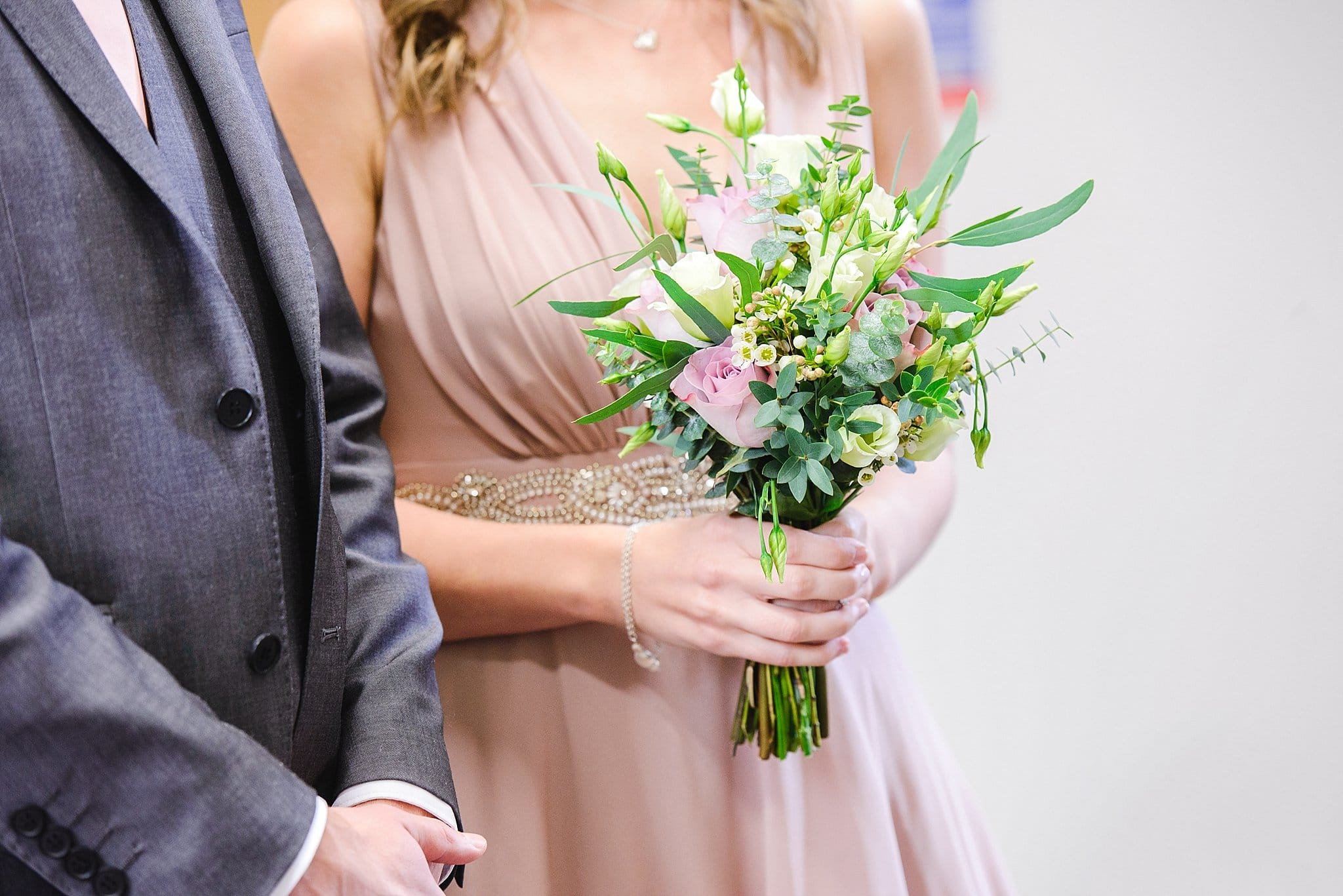 bride holding wedding flowers at her intimate wedding ceremony