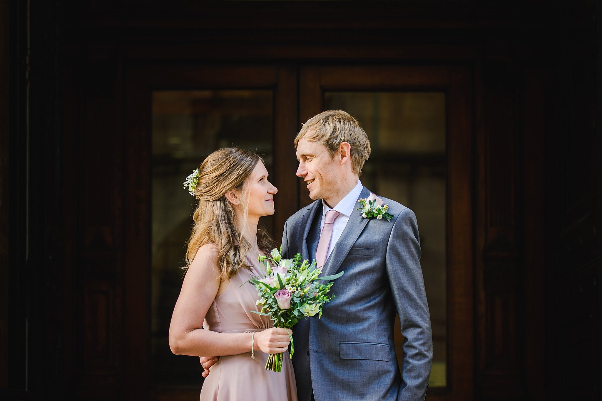 couple on steps of Bristol registry office after their intimate ceremony