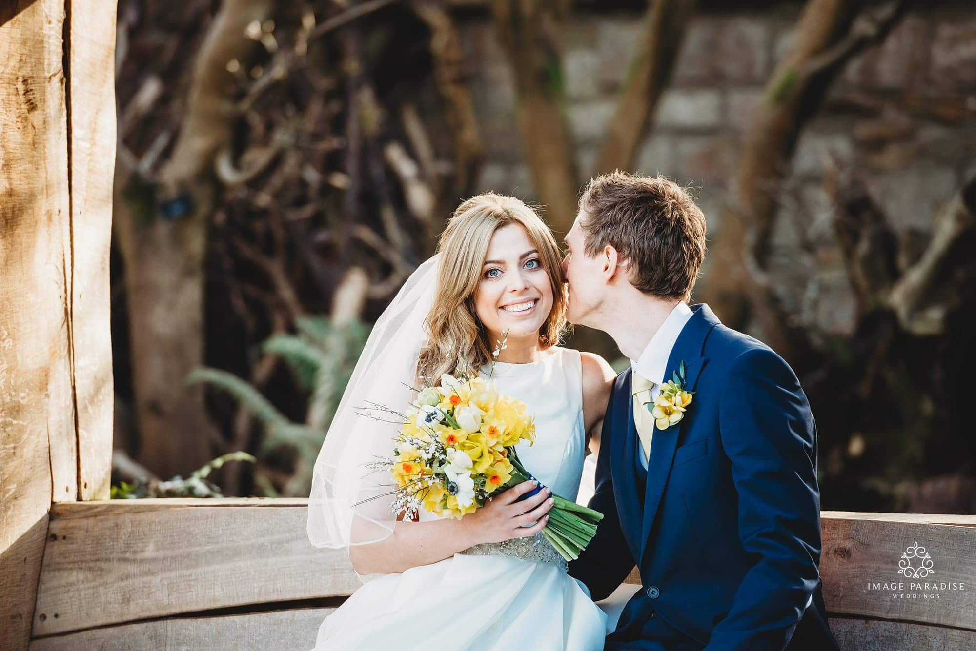 Bride and groom share a moment together in the gardens of their Bristol zoo wedding