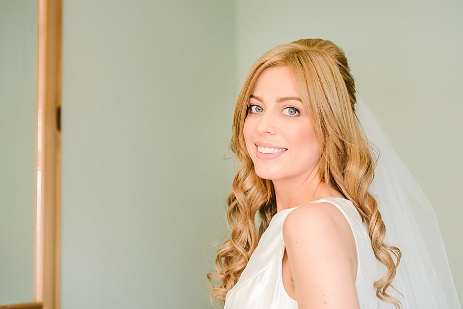 Bride staring into camera before leaving for her wedding at Bristol zoo