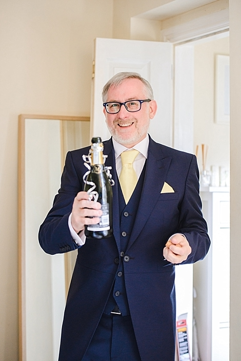 Father of the bride opening champagne for daughters Bristol zoo wedding