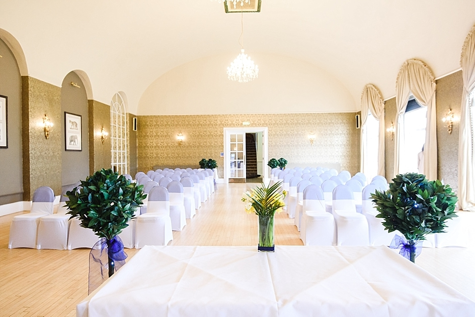 Clifton Pavilion room set up for a wedding at Bristol zoo. Empty room with seats ready for guests.