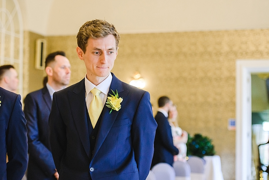 Groom waiting for bride to walk down the aisle at Bristol zoo wedding Clifton Pavilion