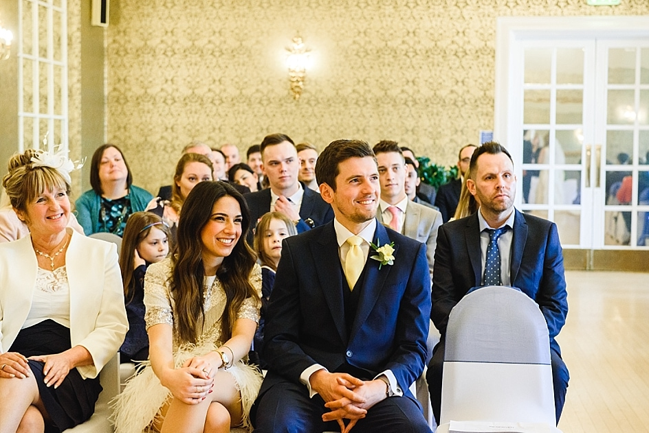 Guests look on at a couple getting married at Clifton Pavilion Bristol zoo wedding