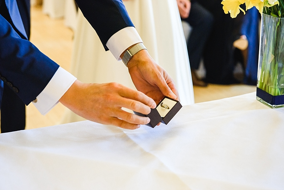 Best man places wedding ring band on the table at Bristol zoo wedding, Clifton Pavilion