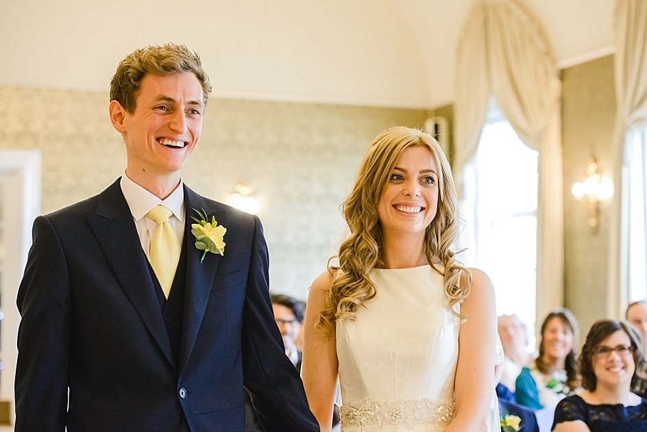 Bride and groom stood smiling at their Bristol zoo wedding at the Clifton Pavilion